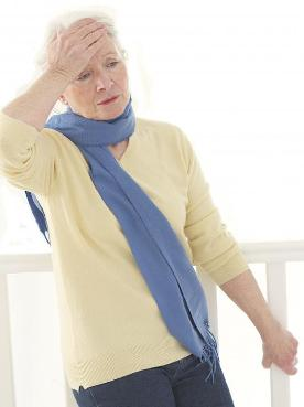 elderly-woman-in-blue-scarf-with-dizziness